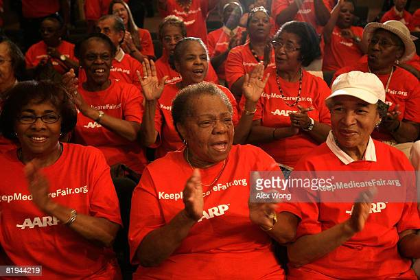 Members of AARP applaud during a rally to support the enactment of the Medicare bill July 15 2008 on Capitol Hill in Washington DC President George W...