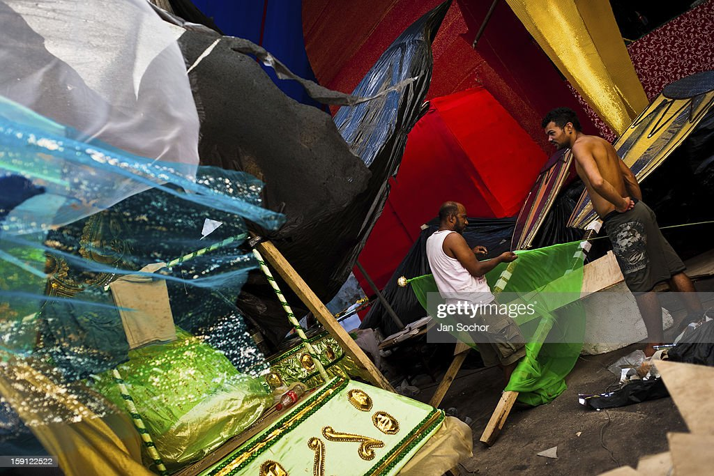 Members of Acadêmicos da Rocinha samba school work on a carnival float inside the workshop in Rio de Janeiro, Brazil, 15 February 2012. The carnival preparations start early in July or August, some 7-8 months before the main samba schools parade at the sambodrome. Samba schools hire teams of professional designers and artists who, according to the original theme selected by the school directors and then featured by the school during the parade, create allegorical floats, costumes, sculptures, music, choreography and the entire school show. However, the most of the everyday work in the carnival hangars is performed by unknown but fully dedicated samba schools members.