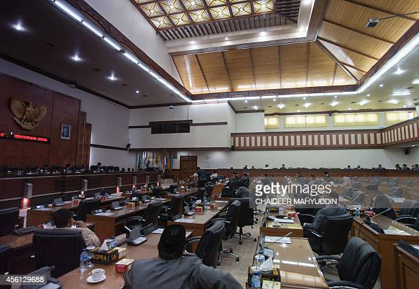 Members of Aceh parliament members hold a general meeting on a sharia law to give 100 lashes for homosexuality in Aceh on September 26 2014 Lawmakers...
