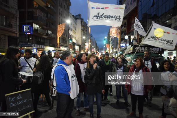 Members of Ademys Association stage a protest with teachers against the government's rejection of salary proposal in Buenos Aires Argentina on August...