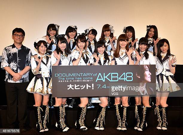 Members of AKB48 and director Eiki Takahashi attend their documentary 'The time has come' press conference at Roppongi Hills on July 3 2014 in Tokyo...