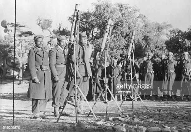 Members of Algeria's 30000 man National Liberation Army stand at attention before their World War II surplus Lewis machine guns The ALN was formed to...