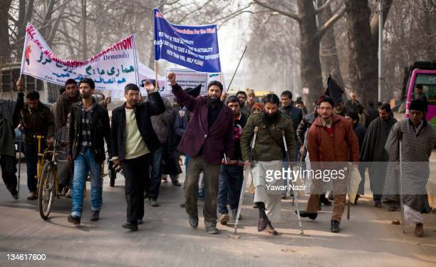 Members of All Jammu and Kashmir Handicapped Association take part in a protest on World Disability Day on December 3 2011 in Srinagar the summer...