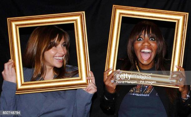 Members of All Saints Melanie Blatt and Shaznay Lewis hold picture frames at a north London studio to highlight Cancer Research UK's Sound and Vision...