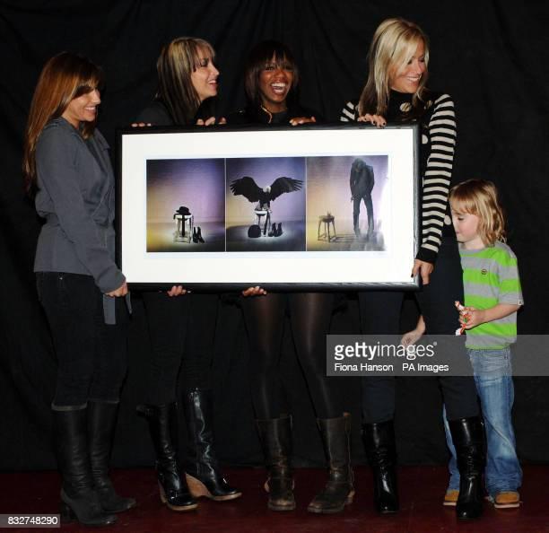 Members of All Saints Melanie Blatt Natalie Appleton Shaznay Lewis and Nicole Appleton hold an image of Pete Doherty by James Dimmock while Nicole's...