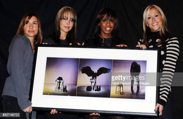 Members of All Saints Melanie Blatt Natalie Appleton Shaznay Lewis and Nicole Appleton hold an image of Pete Doherty by James Dimmock at a north...