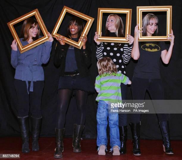 Members of All Saints Melanie Blatt Shaznay Lewis Nicole Appleton and Natalie Appleton hold picture frames while Nicole's son Gene seeks refuge at a...
