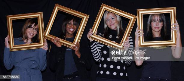 Members of All Saints Melanie Blatt Shaznay Lewis Nicole Appleton and Natalie Appleton hold picture frames at a north London studio to highlight...