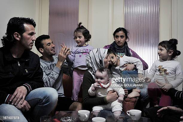 Members of alMassoud family sit in their shared apartment in Athens on April 19 2013 'We wanted to flee Syria and Bashar alAssad now we want to flee...