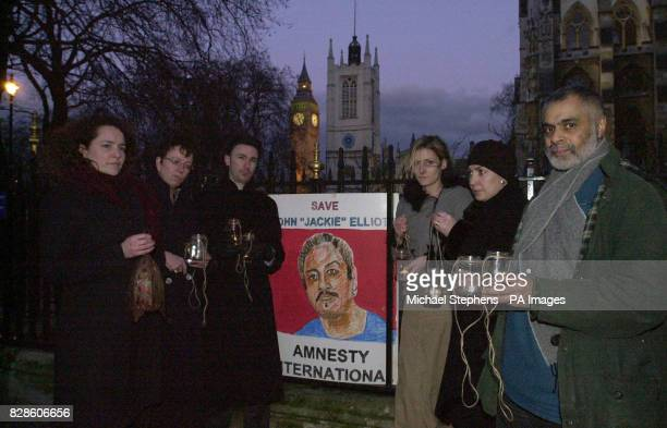 Members of Amnesty International hold a candlelight vigil outside Westminster Abbey to appeal for clemency for John 'Jackie' Elliott who faces...