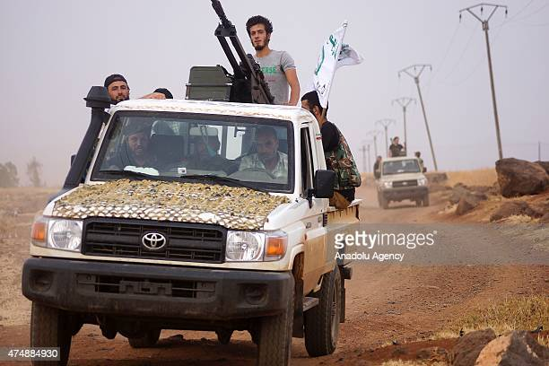 Members of Amud Horan Forces are seen on vehicles before they attack the Syrian regime forces near the Busra alHarir district of Daraa Syria on May...