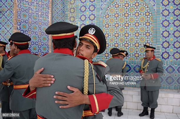 TOPSHOT Members of an Afghan guard of honour greet each other after offering EidalAdha prayers at the Hazrati Ali shrine in Mazari Sharif on...