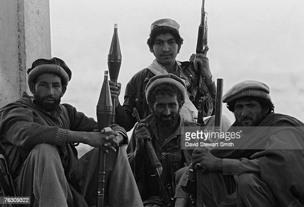 Members of an Afghan Mujahideen group during an advance on Jalalabad Afghanistan March 1989 They are equipped with Kalashnikov assault rifles and...