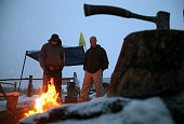 Members of an antigovernment militia gather around a campfire outside of the Malheur National Wildlife Refuge Headquarters on January 7 2016 near...
