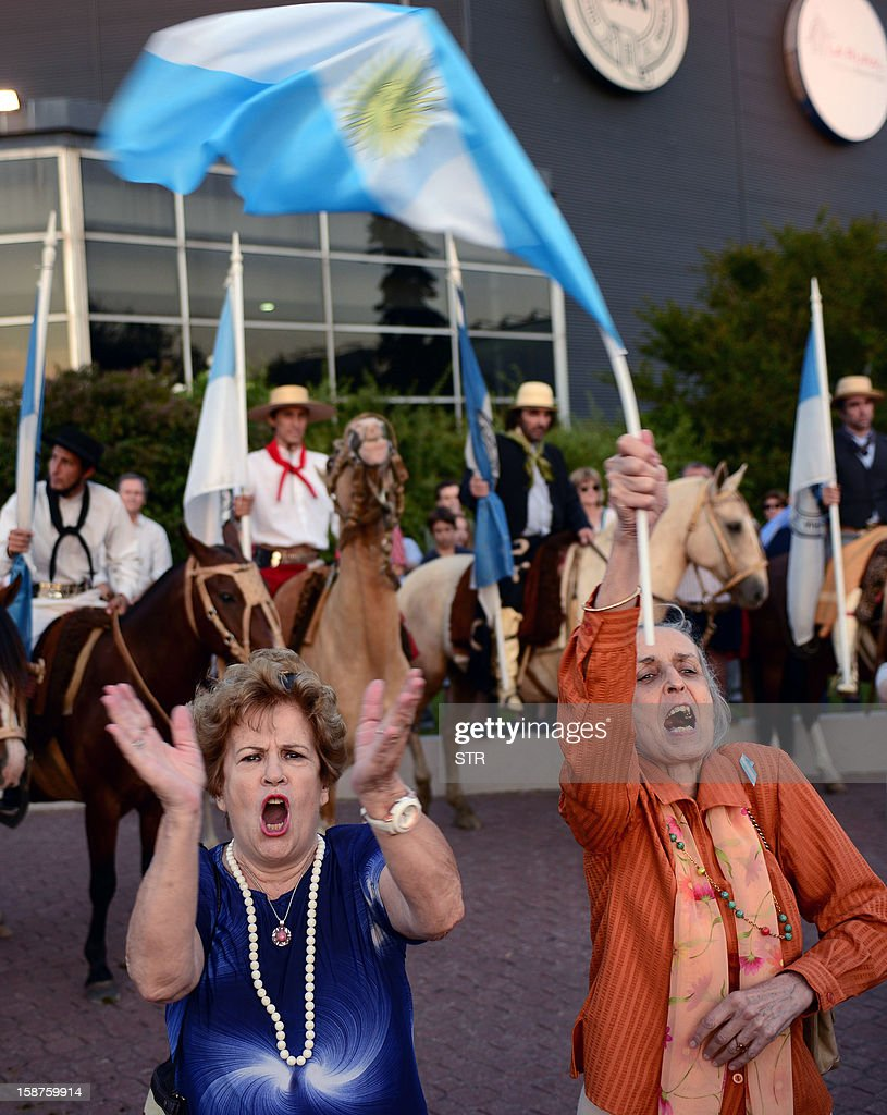 Members of an Argentinian rural organization shout slogans during a protest against a decree issued by President Cristina Fernandez de Kirchner to expropiate the Rural Society grounds and give it back to the state, on December 27, 2012 at the Rural Society grounds in Buenos Aires.