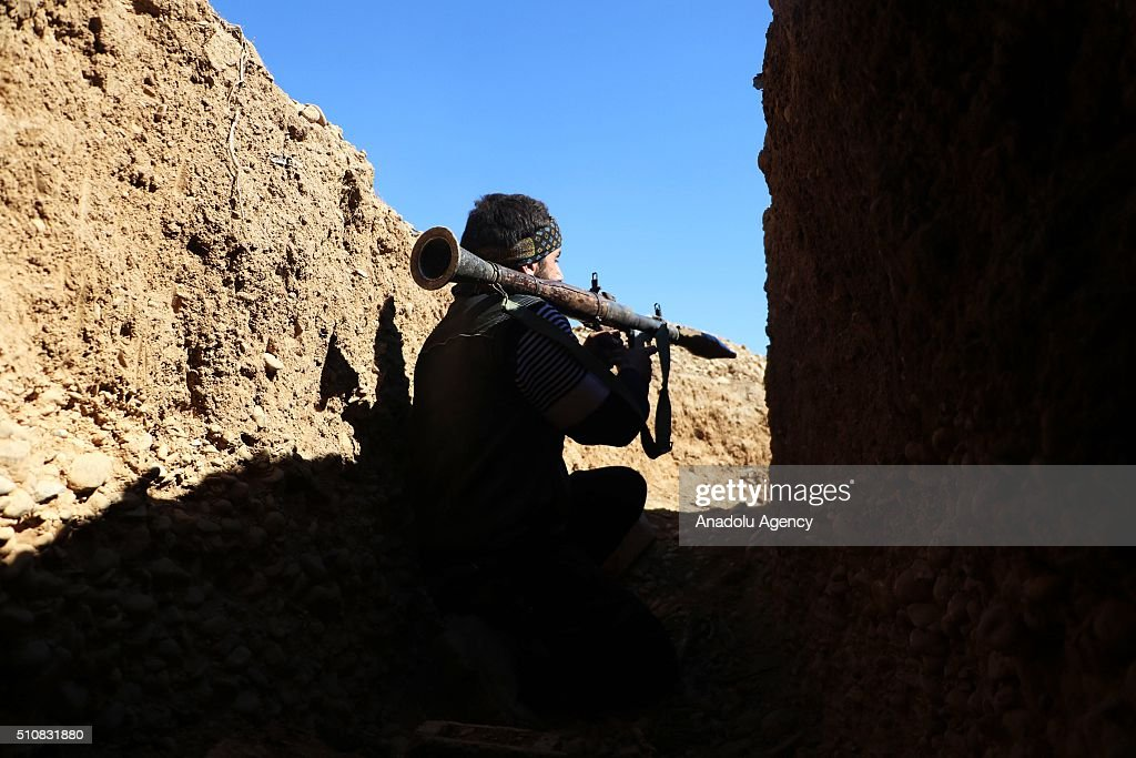 Members of an armed Syrian opposition group are seen at ...