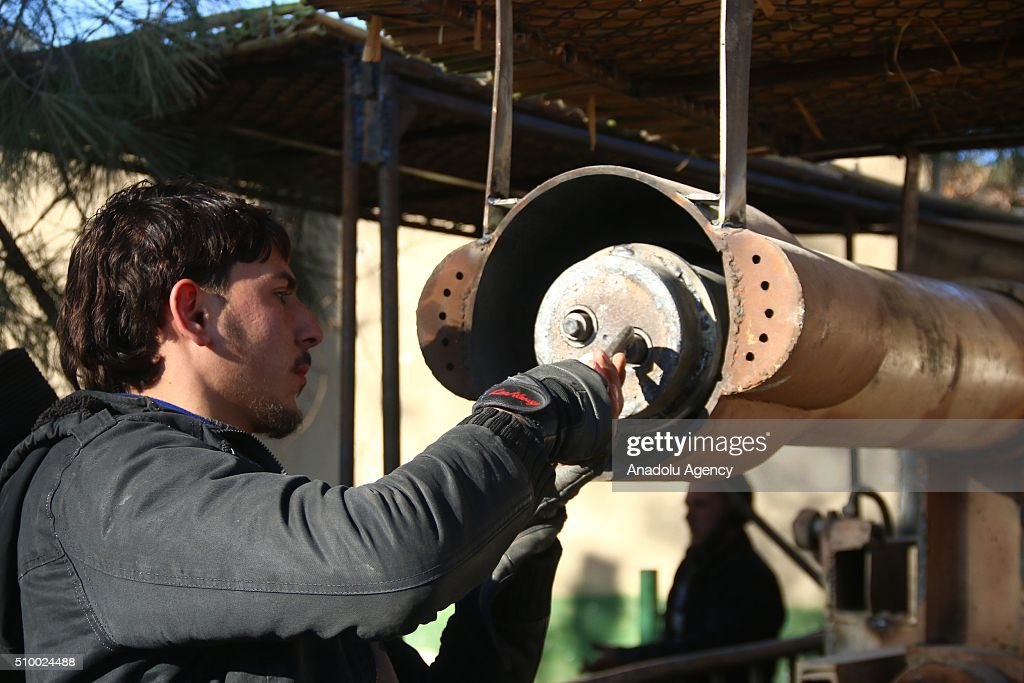 Members of an armed Syrian opposition group get prepared before they attack regime controlled Merch town in the Eastern Ghouta region of Damascus, Syria on February 13, 2016.