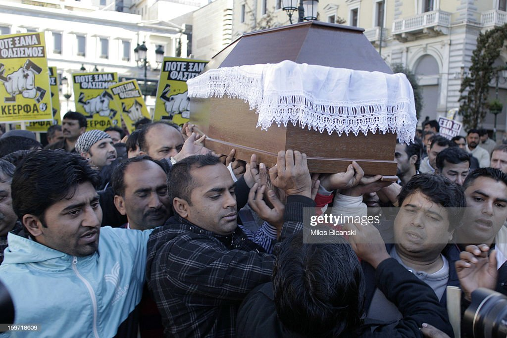 Members of an Athen's Pakistani carry the coffin of a 27-year-old Pakistani migrant who was a victim of an alleged racism-fuelled crime on January 19, 2013 in Athens, Greece. Hundreds of Greeks and other nationals marched peacefully against racism on January 19. Long standing as a hub for immigration from the Middle East, Africa and Asia, Greece is under pressure with racial issues as the economic crisis warps the burdens of blame in struggling communities.
