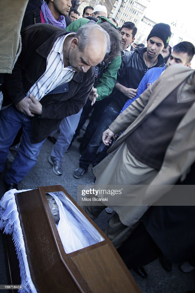 Members of an Athen's Pakistani community gather near the coffin of a 27-year-old Pakistani migrant who was a victim of an alleged racism-fuelled crime on January 19, 2013 in Athens, Greece. Hundreds of Greeks and other nationals marched peacefully against racism on January 19. Long standing as a hub for immigration from the Middle East, Africa and Asia, Greece is under pressure with racial issues as the economic crisis warps the burdens of blame in struggling communities.