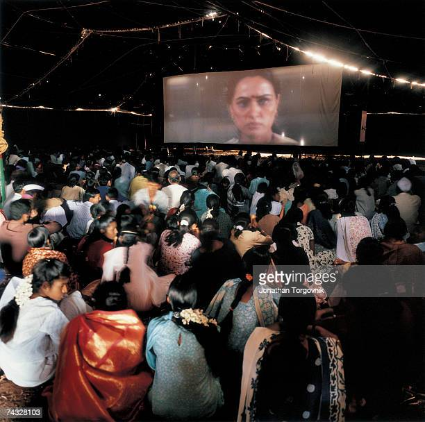 Members of an audience in the interior of the Amar Touring Cinema's tent watch a screening January 2002 in Palli India At many shows including this...