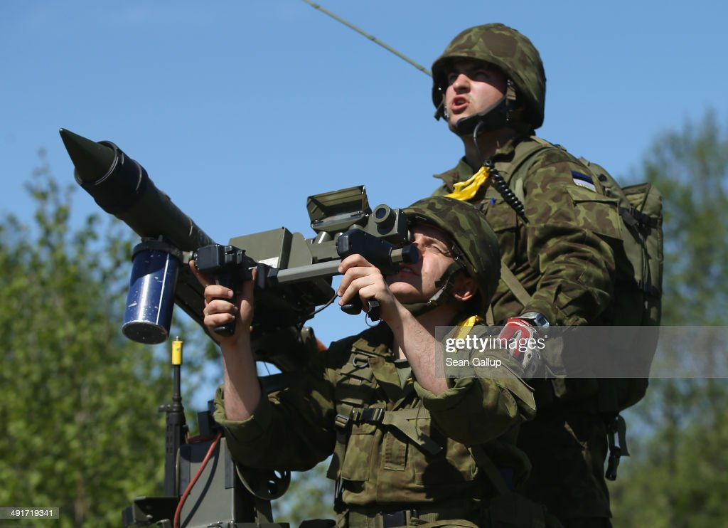 Members of an Estonian antiaircraft unit aim a Mistral antiaircraft missile at a fighter jet overhead while participating in the NATO 'Spring Storm'...