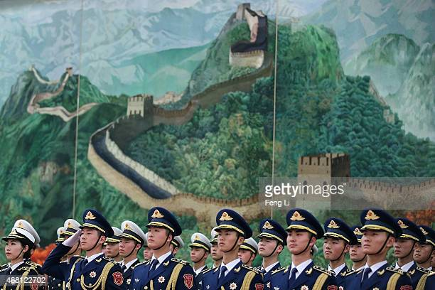 Members of an honor guard march during a welcome ceremony for Australian GovernorGeneral Peter Cosgrove at the Great Hall of the People on March 30...