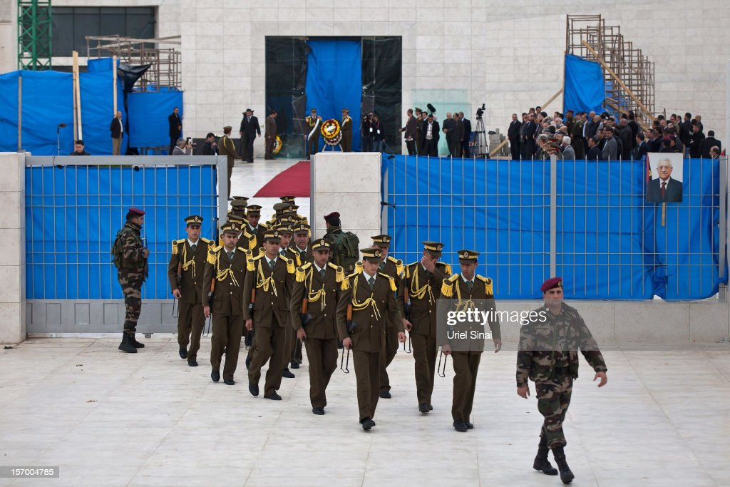 Members of an honour guard leave the mausoleum of Yasser Arafat after a ceremony on November 27, 2012 in Ramallah, West Bank. A team of investigators last night exhumed and reburied the body of former Palestinian leader Yasser Arafat in a bid to determine whether he was murdered by radiation poisoning. The new probe comes after traces of the deadly radioactive isotope, Polonium-210, were found on his clothing. Arafat died of unexplained causes in a French hospital in November 2004.