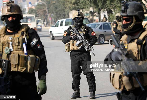 Members of an Iraqi antiterror unit stand guard at a checkpoint in Baghdad on January 06 2011 as bomb and gun attacks across Iraq killed at least...