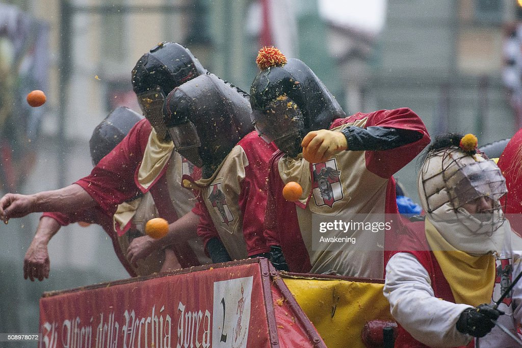 Members of an orange battle team take part in the traditional 'battle of the oranges' held during the Ivrea Carnival on February 7, 2016 in Ivrea, near Turin, Italy. During the event which marks the people's rebellion against tyrannical lords who ruled the town in the Middle Ages, revellers parading on floats represent guards of the tyrant, while those on foot the townsfolk.