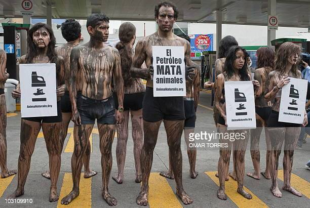 Members of AnimaNaturalis with their bodies covered with black paint protest against the oil spill of BP's drilling well in the Gulf of Mexico on...
