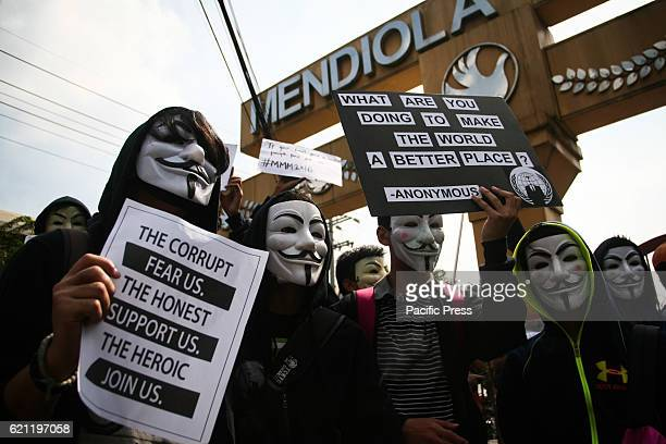 Members of Anonymous Philippines marched to Mendiola Bridge in Manila to participate in the global Million Mask March Wearing Guy Fawkes masks the...