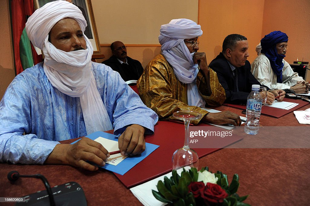 Members of Ansar Dine and Tuareg National Movement for the Liberation of Azawad (MNLA) are seen during a meeting in Algiers on December 21, 2012. Ansar Dine and MNLA, armed rebel groups active in northern Mali, announced their commitment to suspending hostilities and negotiating with the Malian authorities to end the crisis.