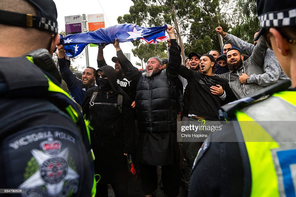 Members of ANTIFA and left leaning protestors bait members of the True Blue Crew in front of police lines in Coburg on May 28, 2016 in Melbourne, Australia. Violence erupted when participants in a 'Say No To Racism' rally protesting the forced closure of Aboriginal communities, off-shore detention centres and Islamophobia met with a counter 'Anti-Islam rally organised by the True Blue Crew and backed by the United Patriots Front.
