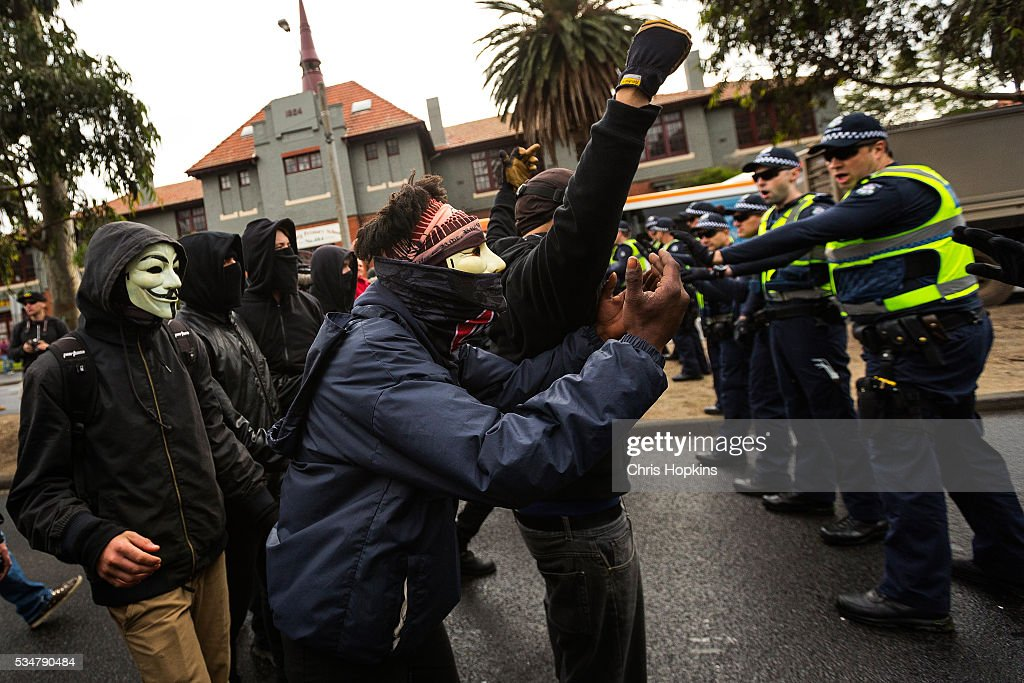 Members of ANTIFA bait members of the True Blue Crew in front of police lines in Coburg on May 28, 2016 in Melbourne, Australia. Violence erupted when participants in a 'Say No To Racism' rally protesting the forced closure of Aboriginal communities, off-shore detention centres and Islamophobia met with a counter 'Anti-Islam rally organised by the True Blue Crew and backed by the United Patriots Front.