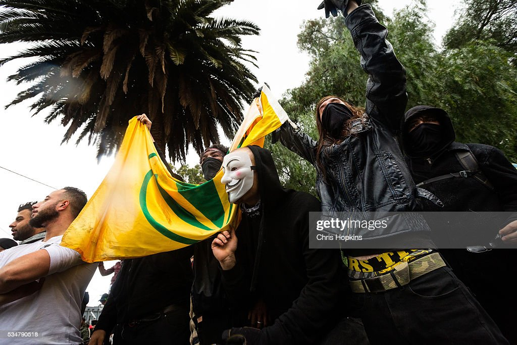 Members of ANTIFA bait members of the True Blue Crew in front of police lines after stealing the United Patriots Front Flag in Coburg on May 28, 2016 in Melbourne, Australia. Violence erupted when participants in a 'Say No To Racism' rally protesting the forced closure of Aboriginal communities, off-shore detention centres and Islamophobia met with a counter 'Anti-Islam rally organised by the True Blue Crew and backed by the United Patriots Front.