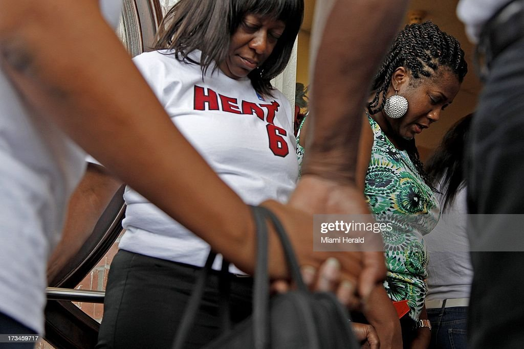 Members of Antioch Missionary Baptist Church, Barbara Darville, left, and Nina Chinery-Hesse, right, bow their heads during a prayer service at Antioch Missionary Baptist Church in Miami Gardens, Florida, Sunday, July 14, 2013. George Zimmerman was found not guilty in the shooting death of Trayvon Martin.