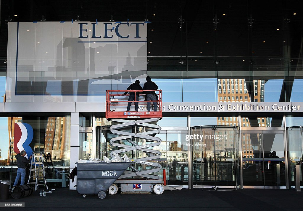 Members of Ardon Vinyl Graphics & Design apply perforated window viny on the windows of the Boston Convention and Exhibition Center as he decoates the venue for Mitt Romney Campaign's election night event November 4, 2012 in Boston, Massachusetts. National polls show that Romney and U.S. President Barack Obama are in dead heat race for the presidential election on Tuesday.