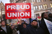 Members of area labor unions and Occupy Wall Street demonstrators participate in a 'March For Jobs and Fairness' on December 1 2011 in New York City...