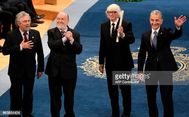 Members of Argentinian comedymusical group Les Luthiers Carlos Nunez Marcos Mundstock Carlos Lopez Puccio and Jorge Luis Maronna acknowledge the...