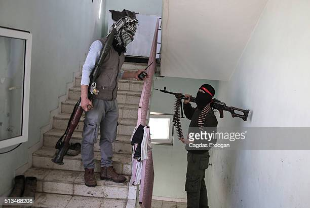 Members of armed group Patriotic Revolutionary Youth Movement a youth division of the Kurdistan Workers' Party PKK talk on the stairs in a house in...