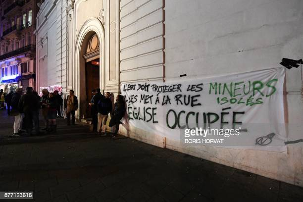Members of association and migrants occupy the church of Saint Ferreol in Marseille on November 21 to protest against the life conditions of...