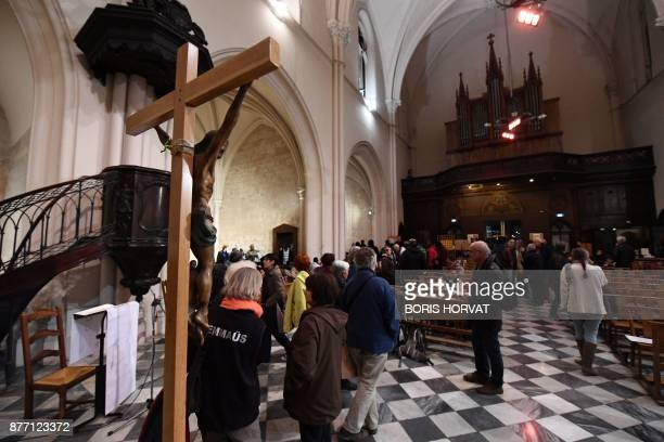 Members of associations occupy with migrants the church of Saint Ferreol in Marseille on November 21 to protest against the life conditions of...