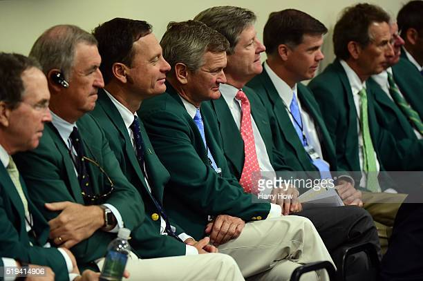 Members of Augusta National listen as Chairman of Augusta National William Porter Payne speaks to the media during a practice round prior to the...