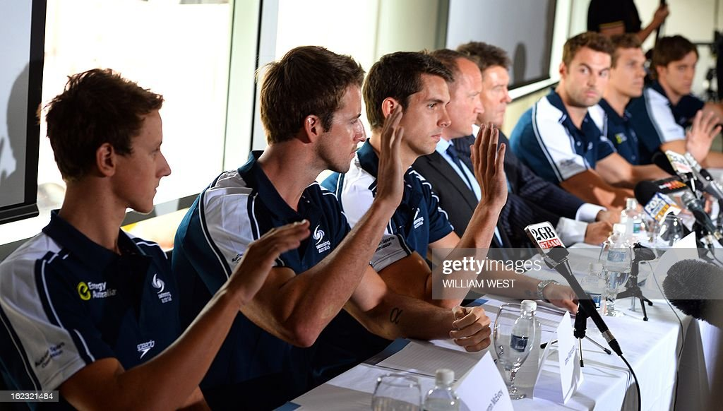 Members of Australia's Olympic swim relay team raise their hands to admit taking Stilnox - a sleeping medication banned by the Australian team - at a press conference in Sydney on February 22, 2013. Australia's much-hyped men's Olympic swim relay team, dubbed the 'Weapons of Mass Destruction' before they failed to win a medal, owned up to taking part in 'stupid' pre-Games pranks. AFP PHOTO / William WEST
