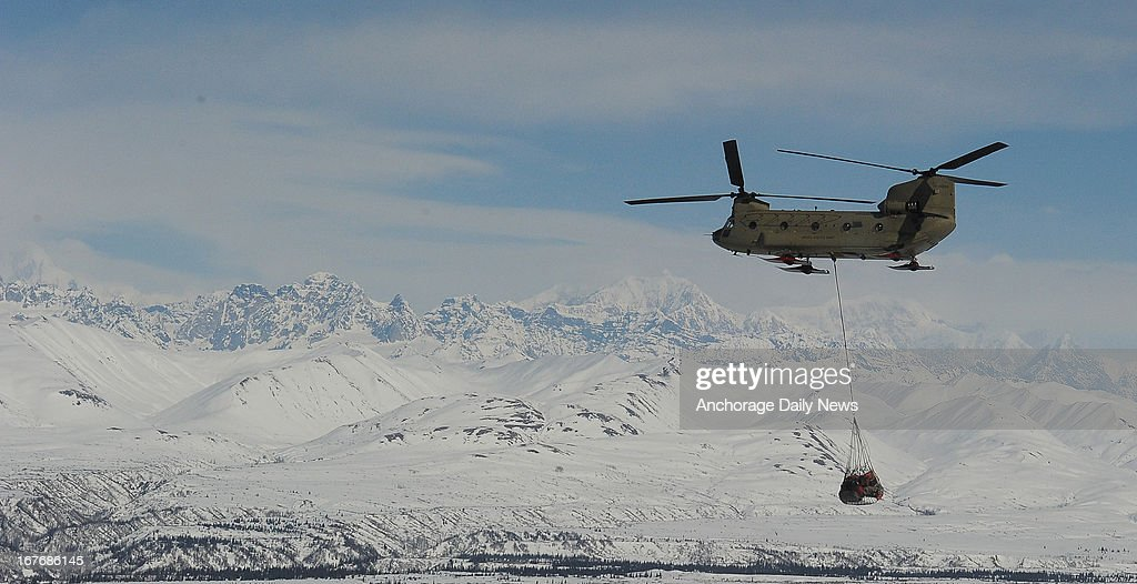 Members of B Company 1st Battalion 52 Aviation Regiment sling a load on a CH47 Chinook Helicopter from the Talkeetna, Alaska, airport to Denali base camp on Friday, April 26, 2013. The unit, known as the Sugar Bears, are flying supplies to the camp on Kahiltna Glacier on Mount McKinley in Denali National Park. The U.S. Army group stationed in Fairbanks receives high-altitude flight training and the Park Service gets their climbing camp up to the glacier.
