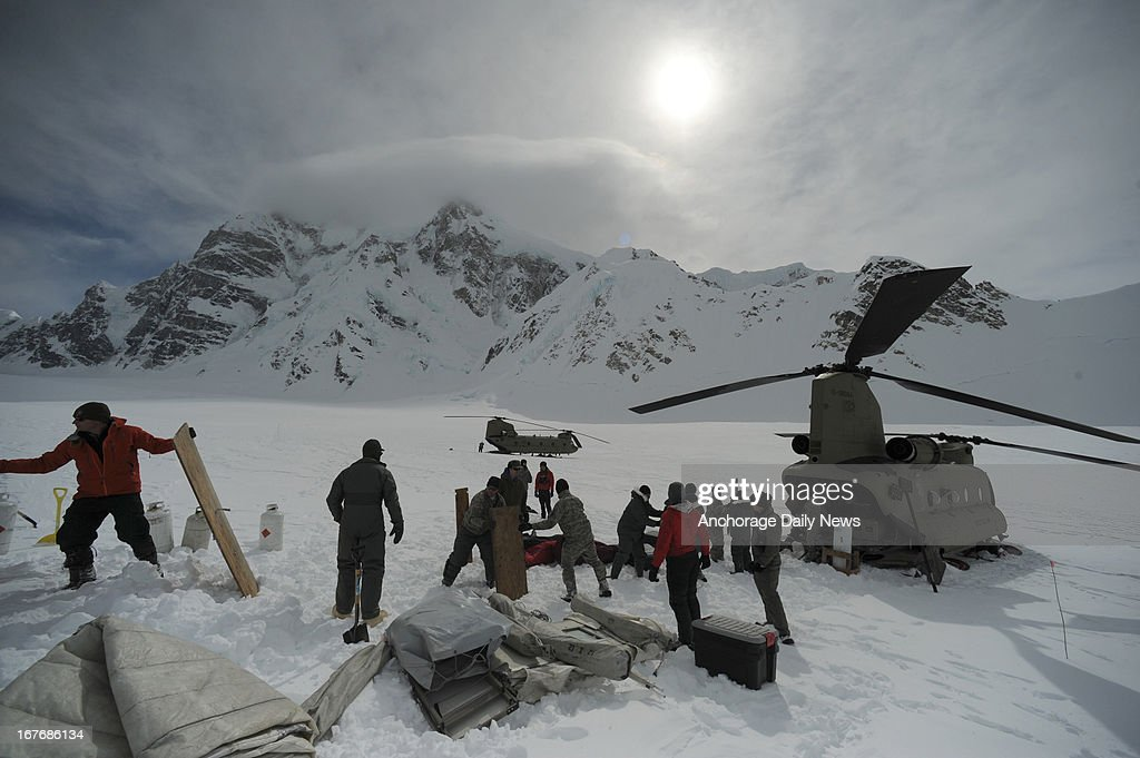 Members of B Company 1st Battalion 52 Aviation Regiment unload a CH47 Chinook Helicopter from the Talkeetna, Alaska, airport at the Denali base camp on Friday, April 26, 2013. The unit, known as the Sugar Bears, are flying supplies to the camp on Kahiltna Glacier on Mount McKinley in Denali National Park. The U.S. Army group stationed in Fairbanks receives high-altitude flight training and the Park Service gets their climbing camp up to the glacier.
