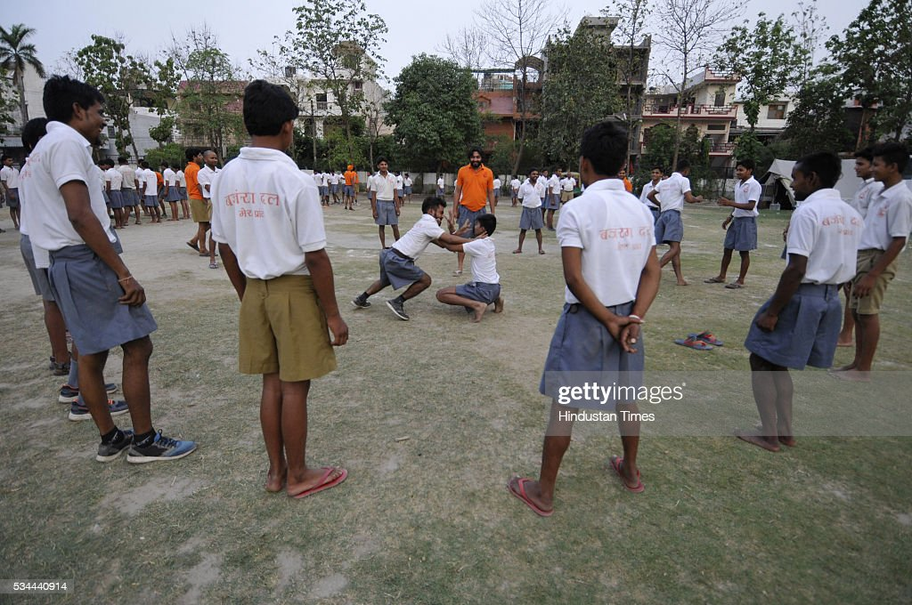 Members of Bajrang Dal displaying combating skills during self defense training camp at Saraswati Shishu Mandir, an RSS-run school on May 26, 2016 in Noida, India. Nearly 400 members from 16 districts of Uttar Pradesh have gathered at the Saraswati Shishu Mandir in Noida for the training session. The training module includes martial arts, hurdle jumping, airgun firing, rope climbing and use of swords and sticks during a combat situation. The arms training camp of Hindu Right Wing oraganisation in communally sensitive Ayodhya has triggered furore earlier this week, prompting Police to arrest the camp organizer Mahesh Mishra .