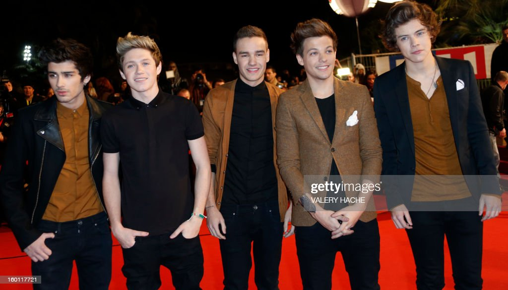 Members of band of 'One Direction' pose upon arrival at the Palais des Festivals during the 14th Annual NRJ Music Awards on January 26, 2013 in Cannes, southeastern France. News that the global music industry has finally turned the corner and is on the road to recovery should help get the annual four-day gathering of many of the world's top music execs at the MIDEM trade fair that opens here Saturday off to a good start.