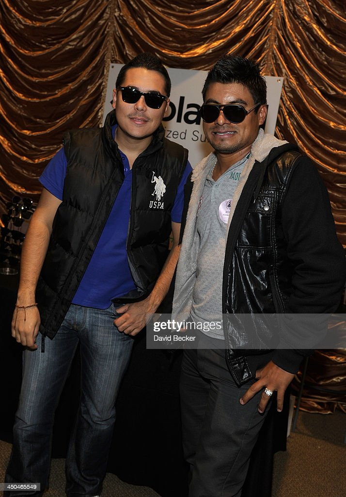 Members of Banda Carnaval with Polaroid Polarized Sunglasses at a gift lounge during the 14th annual Latin GRAMMY Awards at the Mandalay Bay Events Center on November 18, 2013 in Las Vegas, Nevada.