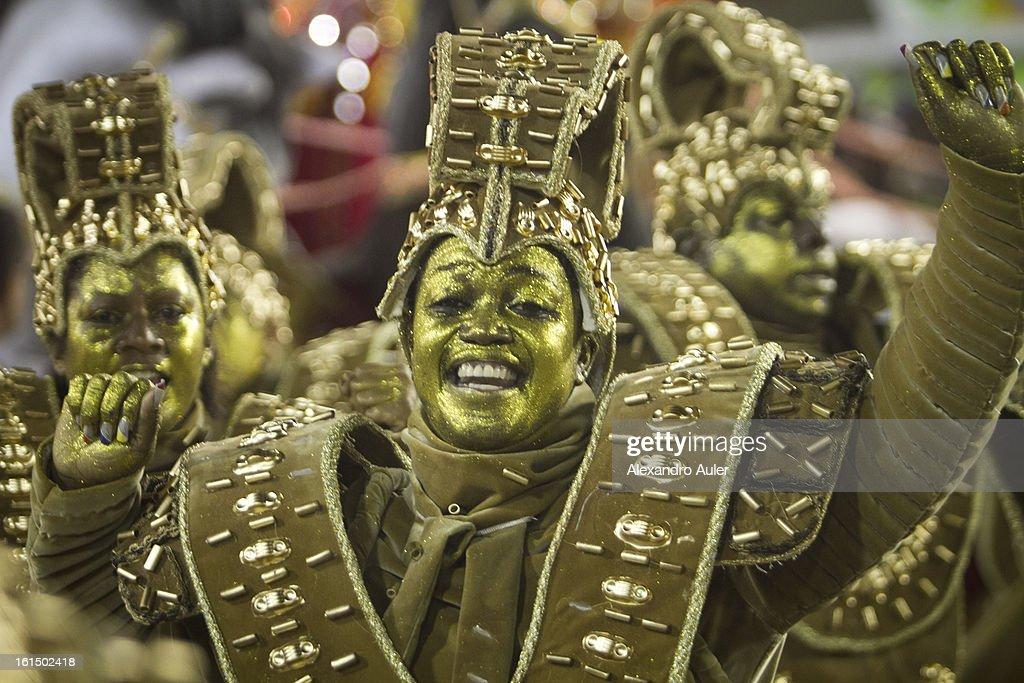 Members of Beija Flor Samba School perform during Carnival 2013 at Sambodrome Sapucai on February 12, 2013 in Rio de Janeiro, Brazil.